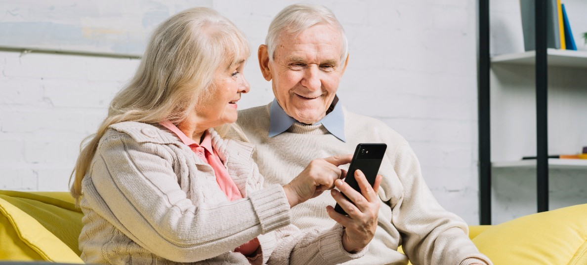 Older couple using mobile phone